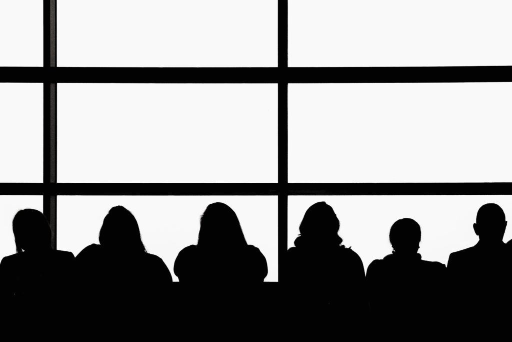 silhouette of people sitting on chair
